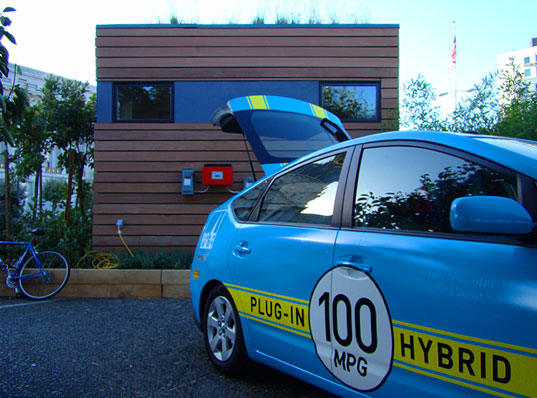 Electric car charging, MK Lotus House, rainwater catchement, rainwater collection pond, West Coast Green, Michelle Kaufmann, prefab green home, green prefab house, net zero energy house, prefab home on lawn of San Francisco City Hall