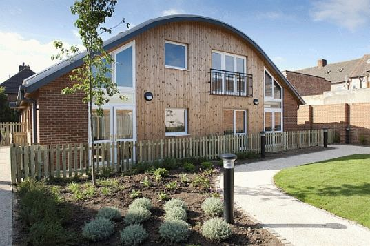 Affordable Housing Meets Green Building In Prefab Birchway Eco Community