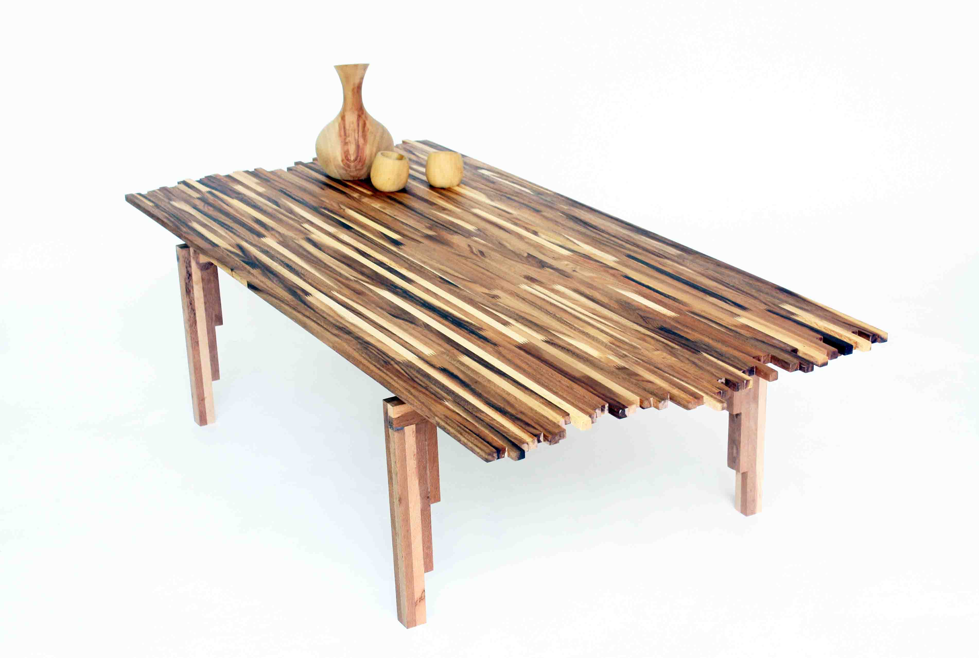 beautiful wildfire table made from multitone scraps of acacia wood inhabitat green design innovation green building