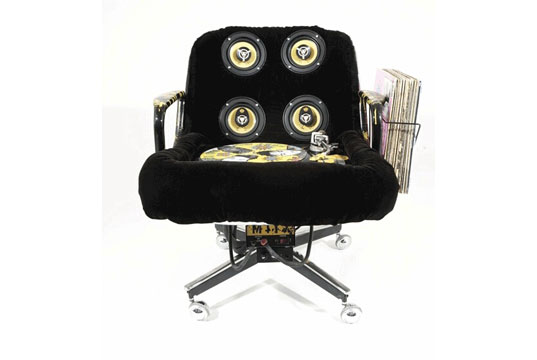 Eames chair fitted with sound equipment, mikal hameed, musical experience, musical performance, environmental art, interactive art, interactive music, interactive objects, recycled materials art