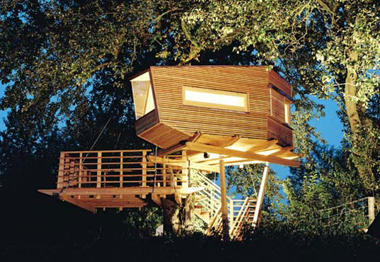 nestled amidst lush pine and magnolia trees this treehouse from baumraum updates a traditional backwoods form with a sharp modern profile