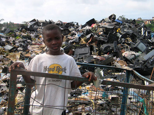 TAKEBACK MY TV: Think Before You Recycle, Basel Action Network, African kids sitting on e-waste, E waste, Electronics waste, electronics landfill, toxic tech, electronic waste in china, Take back my TV, boy.jpg