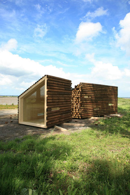 Olgga s portable log cabin conceals a sleek modern for Log home architects