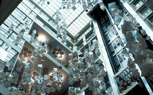Genzyme Center, Cambridge, Massachusetts, biotechnology company, LEED platinum rating, genetics research center, green atrium. Behnisch, Behnisch, and Partners, heliostats, giant mirror chandelier, rain water collection system, 12-story atrium