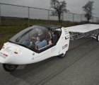 The ICARE Project: A Trip Around the World in a Solar and Wind-Powered Car