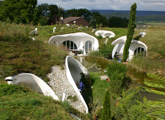 earth house, vetsch architektur, Lättenstrasse estate, grass  covered house, grass roof, green roof, underground house, underground  home, buried house, daylighting, green architecture, sprayed concrete,  eco architecture, green design