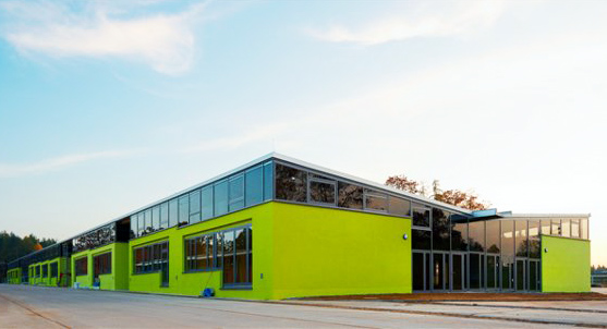 German green school, HHS Architecken, thin film solar roof, solar translucent roof, solar windows, repurposed school, reused building, solar powered school, natural ventalation