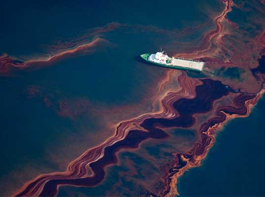 a discussion about the environmental dangers caused by oil spills Scientists already debate about how best to clean up spills  these detergent- based substances cause oil to bead up into tiny droplets  underwater currents  can then theoretically dilute the oil and its risk to the environment.