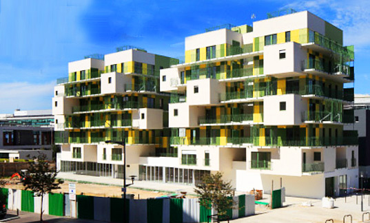 KOZ Completes 28 Green (Literally) and Yellow Stacked Apartments ...