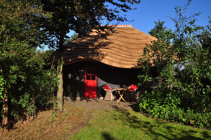 Dutch Barn With Peaceful Undulating Roof Made Of Local