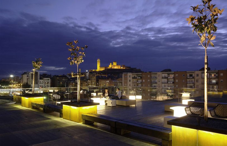 Green Roofed La Llotja Theater Takes Color Cues From The