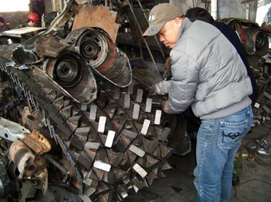 Jiang Chen, Yang Junlin, chinese designers, wing wah metal crafts factory, transformers megatron tank, megatron tank, scrap metals, recycled materials