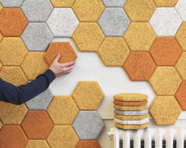 Form Us With Love's wood wool tiles being applied to a wall