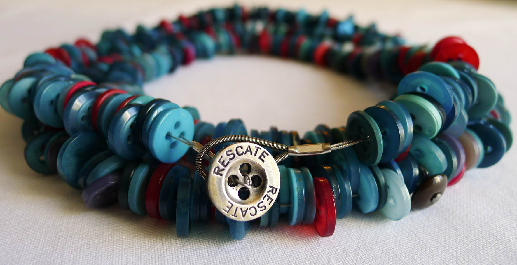 Quirky necklaces made from reclaimed factory floor buttons for Things made from waste bangles