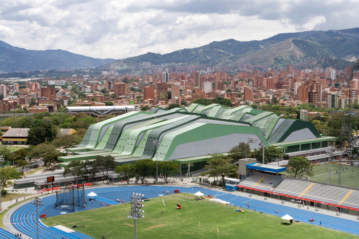 Medellín Sports Coliseum with mountains