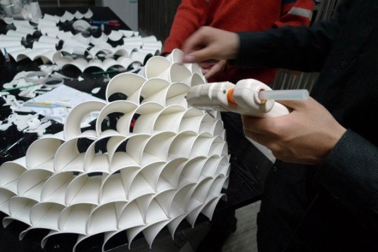 Recycled paper cup lamp is a glowing honeycomb of light