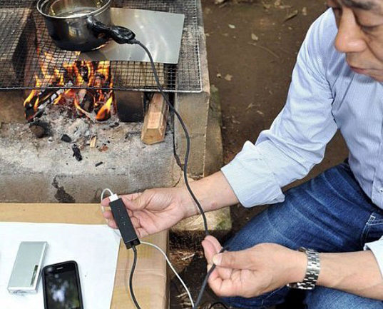 cell phone campfire, charge your cell phone camping, green technology, Hatsuden-Nabe, alternative charging device, sustainable design, green design, renewable energy, charging cookware, phone charging pot