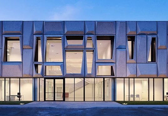 Gorgeous Geometric Facade Crowns Solar Powered Office In Italy