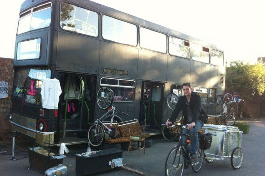 the bicycle library, bicycle library, bike library, bike rental, green design, eco design, sustainable design, green architecture, eco architecture, rent a bike, repurposed double decker bus, recycled double decker bus