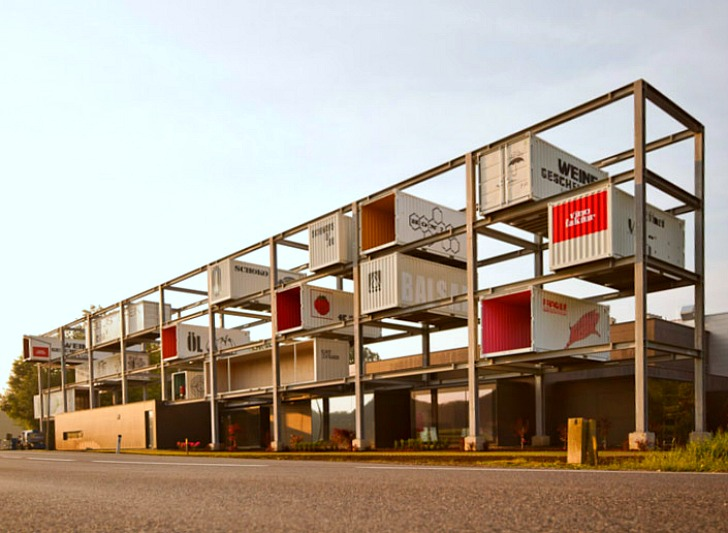 Genussregal Stacked Shipping Container Showroom Springs Up In In