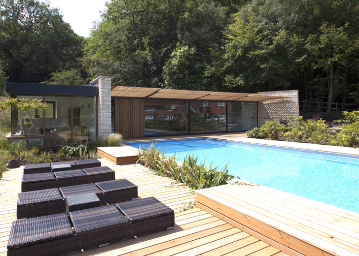 Roundles a modern pool house made of local limestone is a for 50000 pool design