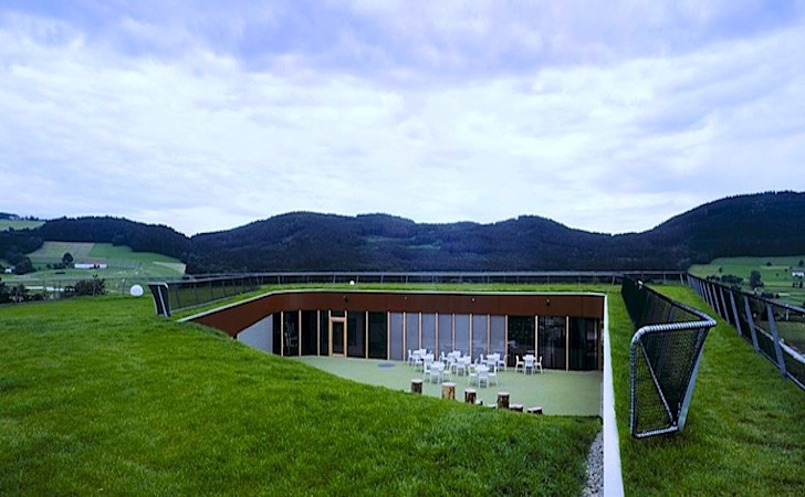 Golfers can tee off on this zero energy clubhouse 39 s green for Clubhouse architecture design