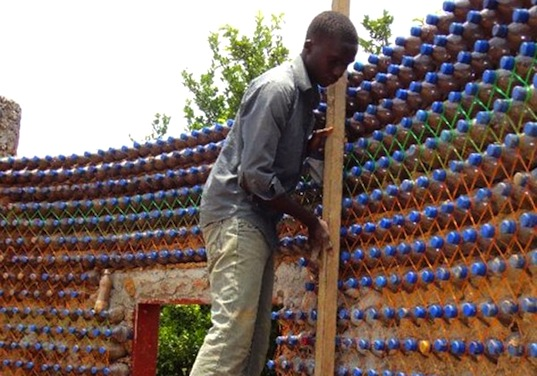 Africa's First House Made of Plastic Bottles in Nigeria « Inhabitat on toothpick house designs, box house designs, wooden doll house designs, birdhouse house designs, glass house designs, playing card house designs, miniature house designs, pump house designs, boxcar house designs, tube house designs,