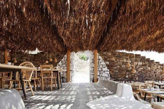 green roof,Green Materials,Green Lighting,green Interiors,Eco Travel,Architecture,pumpking lights,reed roof,greece,mykonos,seaside restaurant,Cycladic Architecture,lime white,locally sourced materials,local stones