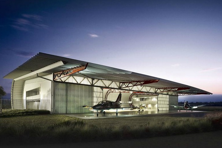 Material efficient plane hangar museum takes inspiration for Aircraft hanger designs