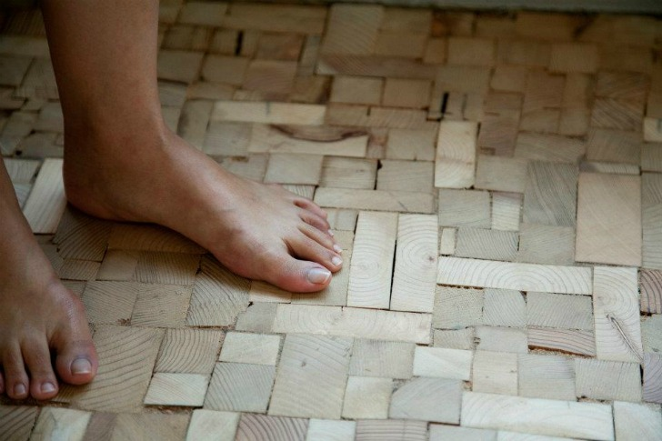 Cost Effective Flooring puzzling patchwork bedroom floor created from timber offcut scraps