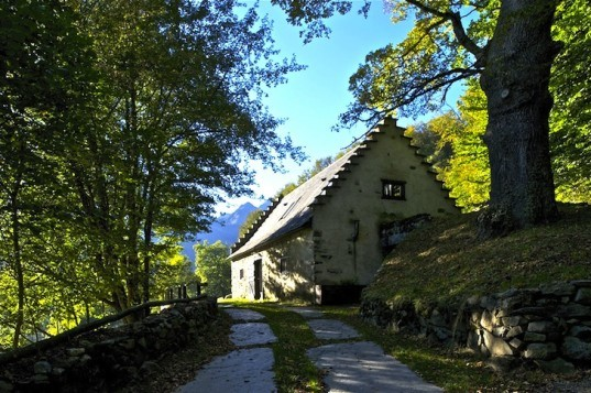 adaptive reuse, retaining wall, green design, sustainable design, Lesponne River, France, Pyrenees Mountains, eco-design, green roof, renovation, barn extension, PPA Architects, natural materials, stone, daylighting, eco-design