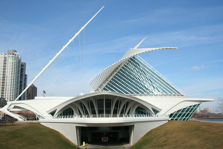 "Spanish starchitect Santiago Calatrava's design for the Milwaukee Art Museum is as inspiring as the 25,000 works of art it houses. The concrete Quadracci Pavilion was the architect's first completed project in the United States, and includes a moving brise soleil, which ""opens"" like a pair of wings, to a ""wingspan"" of 217 feet. The wings can then close over the structure at night or during poop weather conditions. The astonishing building has since become the symbol of Milwaukee as a..."