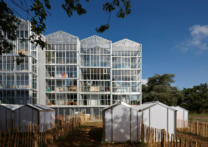 light green house boral is a glass clad greenhouse housing project in france