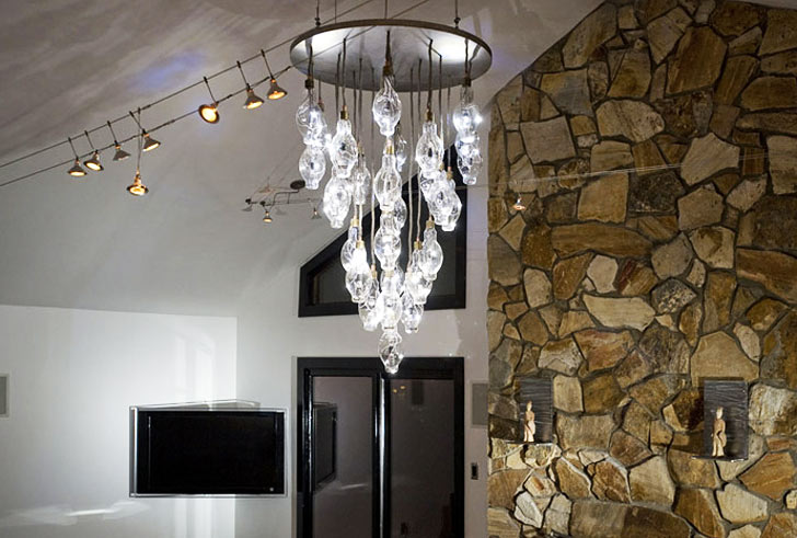 Brcs halide chandelier transforms 28 disused lightbulbs into a to a central point but the dazzling crystals are not like ordinary chandeliers in a statement that celebrates the practicality of energy efficient aloadofball Gallery