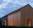 Portuguese Barn Transformed into Sun-Drenched Louvered Residence