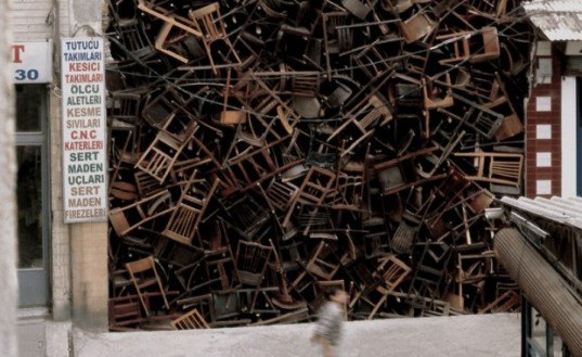 doris salcedo, istanbul biennale, chair installation, furniture art, colombian art, site-specific sculptures, public artwork, reclaimed furniture, reused items