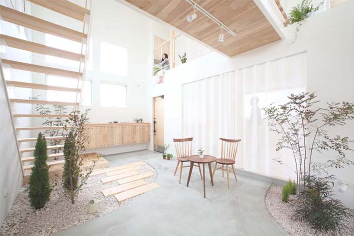Simple Japanese Kofunaki House Has Small Trees And Shrubs