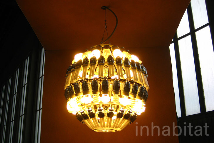 Glimmering glow chandelier is made from recycled cfl bulbs upgraded design aloadofball Image collections