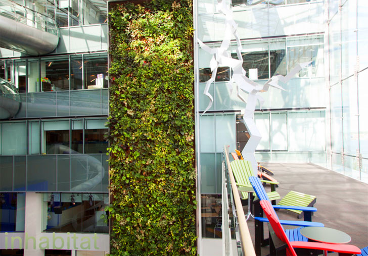 Torontou0027s Corus Quay Building Boasts A 5 Story Living Wall And Indoor Slide!