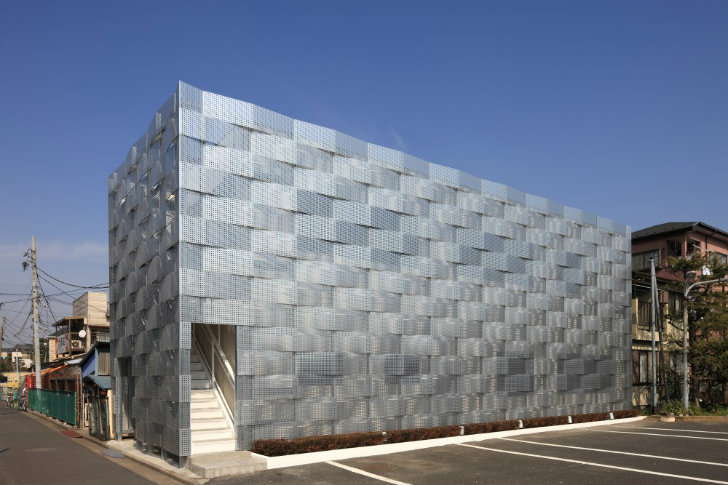 Edogawa Garage Club Receives A Modern Woven Shade Screen