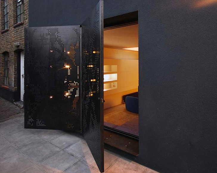 Laser cut butterfly door allows natural light into londons hidden architecture planetlyrics Gallery