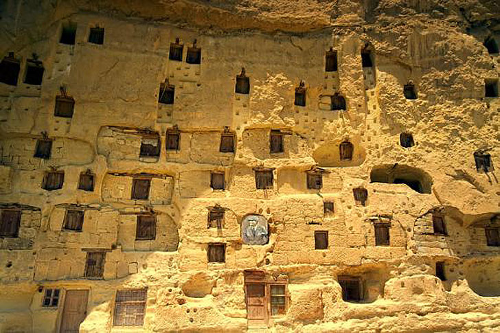 Centuries old manazan cave city is carved out of a sheer