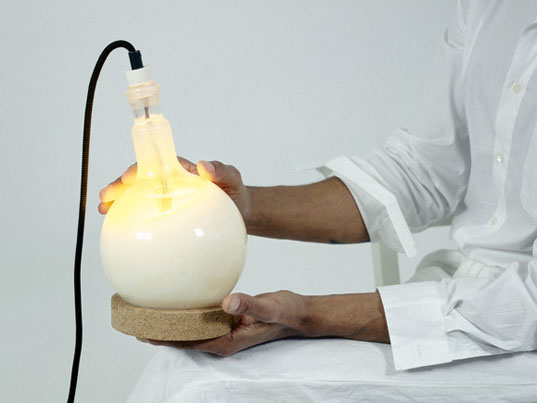 Droog Design's Slow Glow Table Lamp Changes Brightness by Melting ...