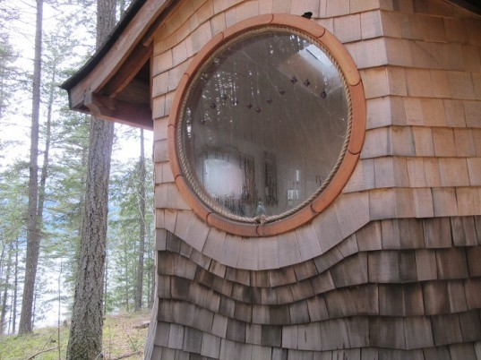 round window, curved roof, house in the woods, handsplit shingles