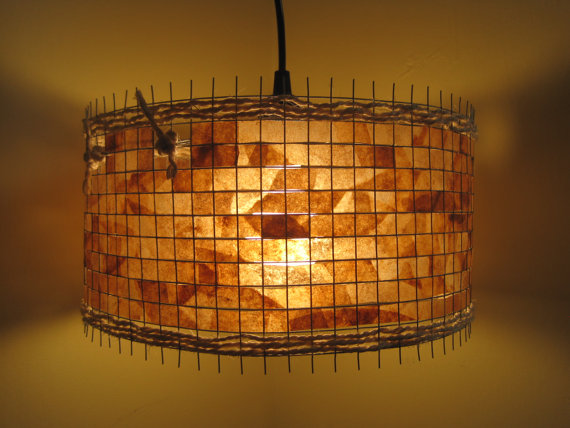 Artistic Light Fixtures lampada recycles soiled coffee filters into artistic light