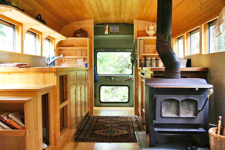 clunky old school bus is converted into a sweet earthy home with a rh inhabitat com bus turned into home bus transformed into home
