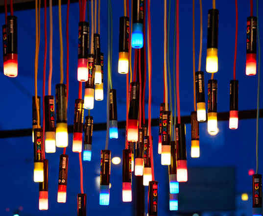 colorful chandelier lighting bright colored design ambience lighting repurposes old posca markers into colorful