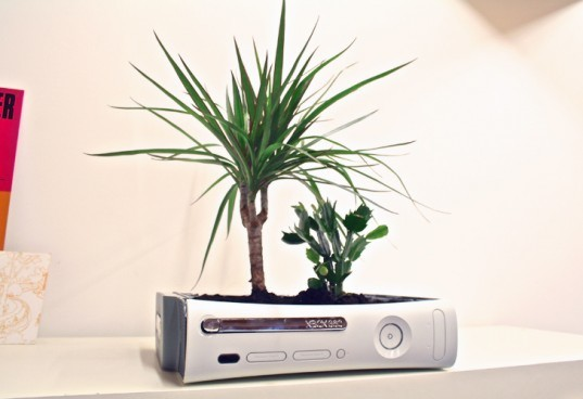 curly productions, xbox 360, xbox 360 planter, recycled video game system, green design, recycled materials, indoor planter. sustainable design, recycled e-waste, gardening, indoor gardening, repurposed video game console, recycled xbox