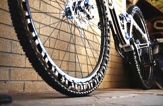 Energy Return Wheels, Britek Tire and Rubber, mountain bike design, high-tech design, carbon fiber tires, airless bike tires, sustainable cycling, eco-friendly design