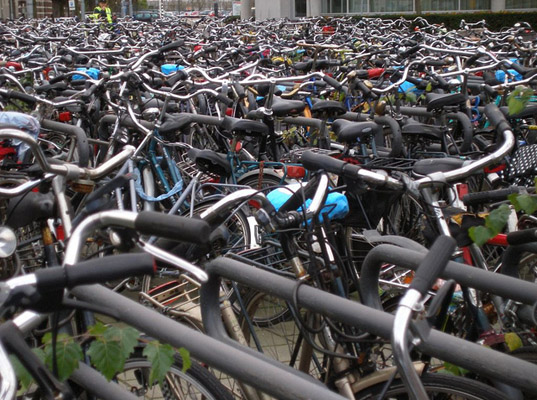 Netherlands bicycle overcrowding, Belgium bike lane use, Dutch lane rage, Dutch bicycle commute, commuting by bicycle, bicycle travel, Amsterdam bicycle parking, green transportation
